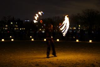Luminary Loppet 2014   Fire performers on Lake of the