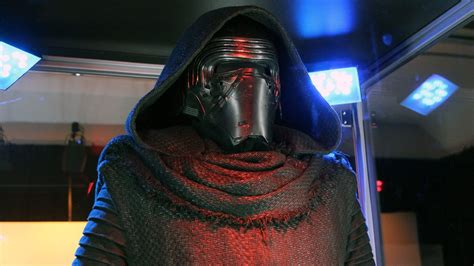 Get a closer look at the lightsaber and mask of Star Wars