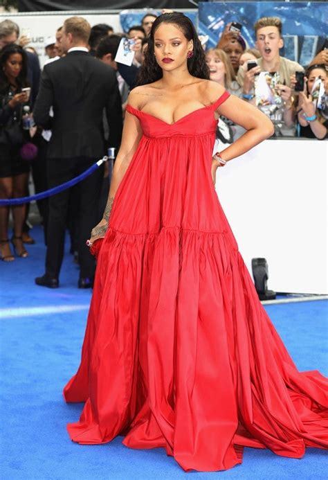 Rihanna Shows Major Cleavage in Head-Turning Red Dress at